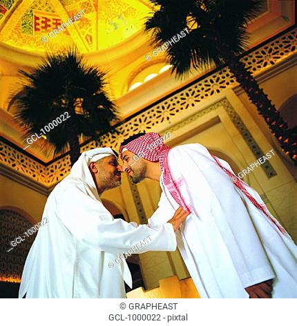 Nose traditional greeting stock photos and images age fotostock arab men rubbing their noses traditional arab greeting m4hsunfo