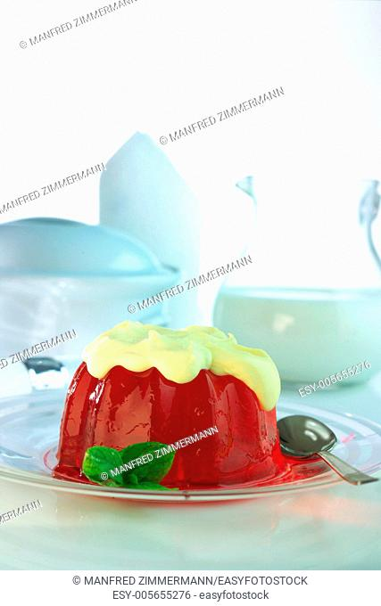 Red Wackelpuding front of white decoration