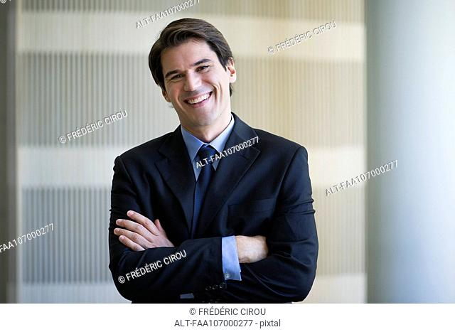 Businessman smiling cheerfully, portrait