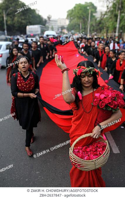 DHAKA, BANGLADESH - MARCH 25 : Students of a theatre school of Acting and Design take out a Lal Jatra procession in remembrance of 'Black Night 1971' in Dhaka