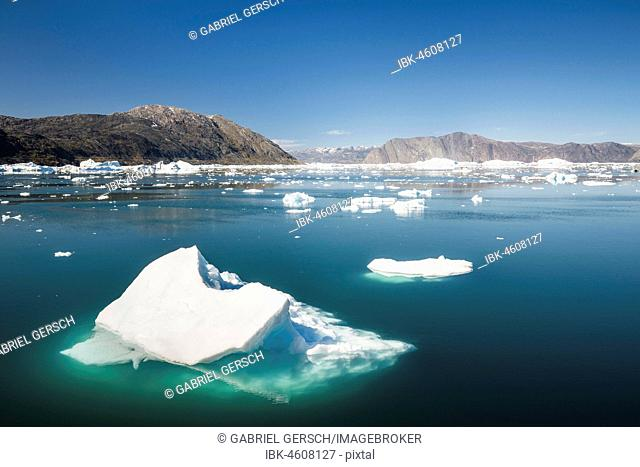 Icebergs in the fjord, surrounded by mountains, West Greenland, Greenland