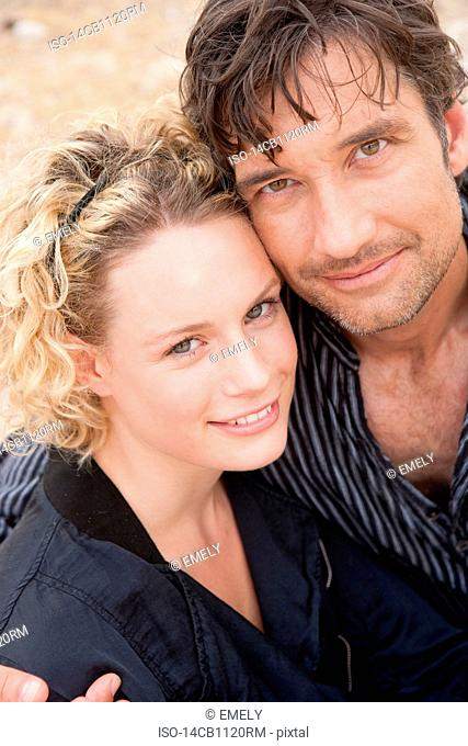 couple embracing smiling at viewer