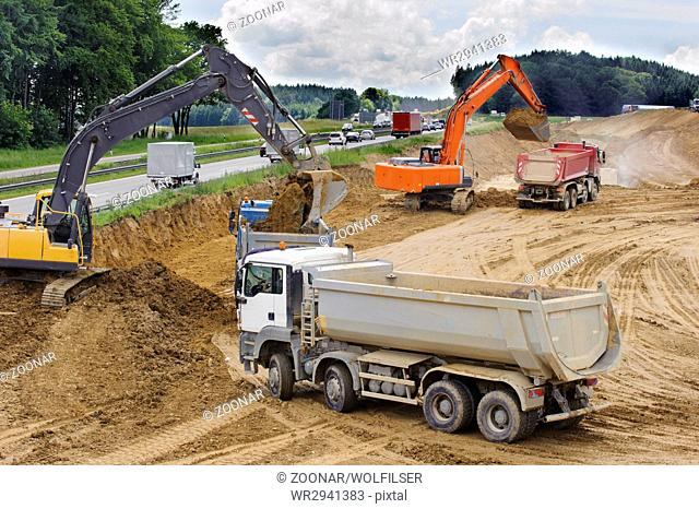 Tractor moving dirt at construction site Stock Photos and