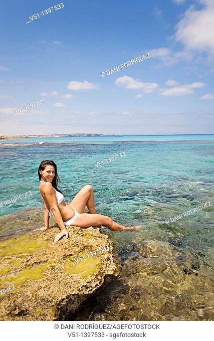 Woman relaxing in a beach in Formentera, Balearic Islands, Spain