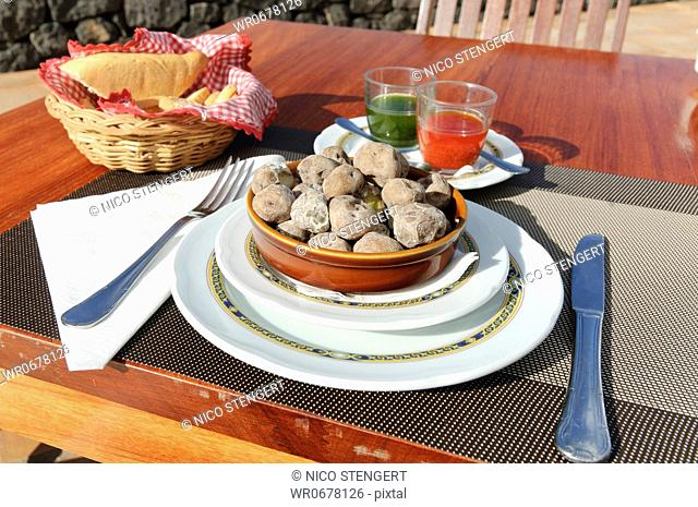 Traditional Canarian cuisine, Canarian wrinkly potatoes, Papas Arrugadas with Rojo Mojo and Mojo Verde sauces, Tenerife, Canary Islands, Spain, Europe