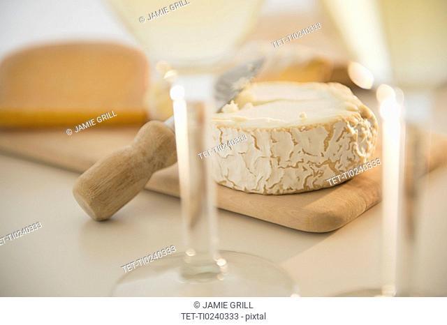 Studio shot of cheese on chopping board