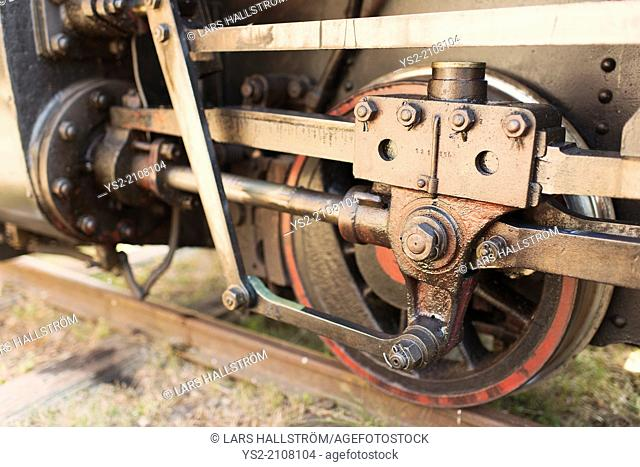 Close up of wheel on old steam train locomotive, Sweden