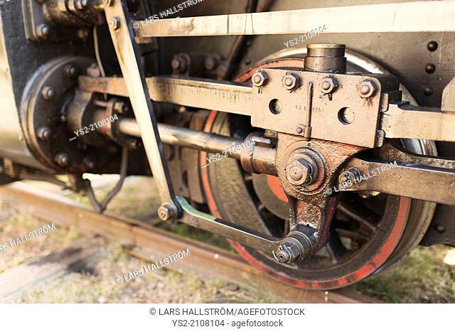 Close up of wheel on old steam train locomotive, Sweden
