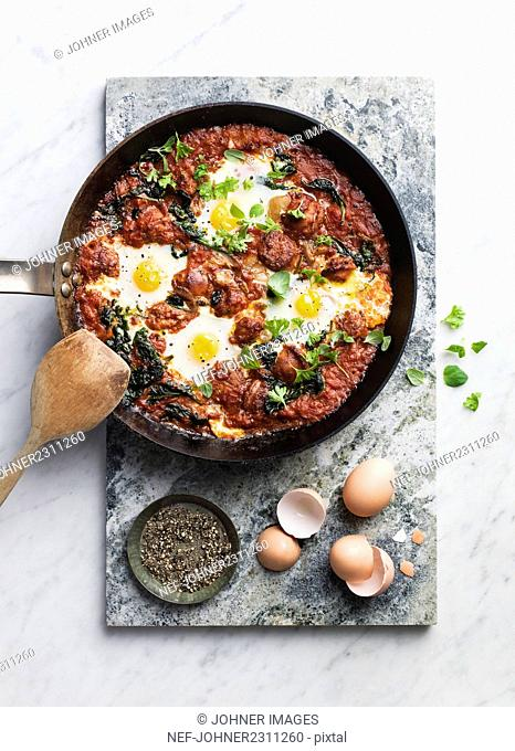 Fried meat with eggs