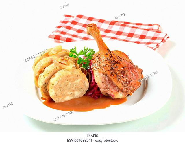 Roast duck with bread dumplings and red cabbage
