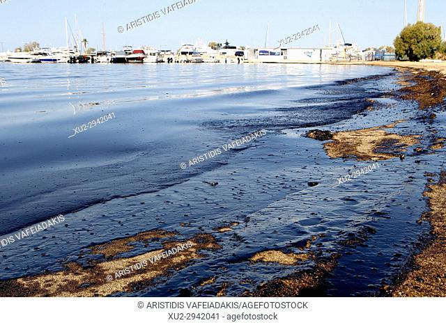 Greek officials traded accusations Wednesday after an oil spill from a sunken tanker drifted to other parts of the Saronic Gulf in Athens