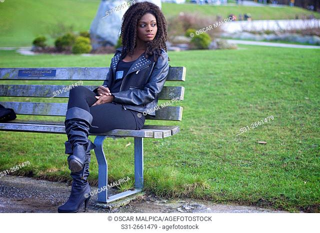 portrait of a cool African Canadian girl posing along the seawall in Vancouver Canada