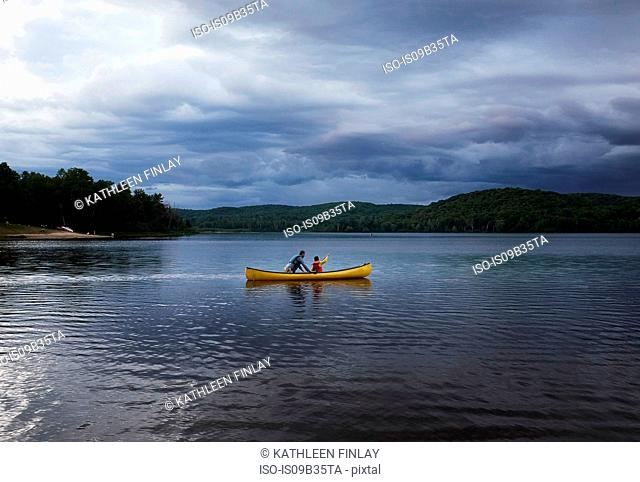 Father and son canoeing on lake, Arrowhead Provincial Park, Ontario, Canada
