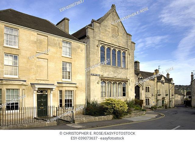 England, Gloucestershire, Cotswolds, Painswick, cotswold stone houses, autumn sun, street scene