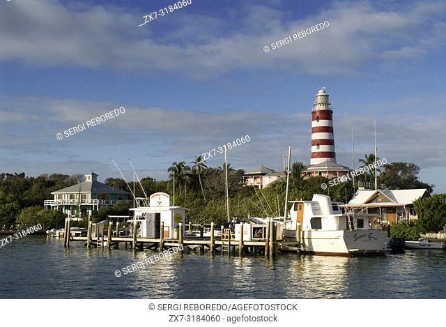 Hope Town lighthouse, Elbow Cay, Abacos. Bahamas. Lighthouse and harbor in the tiny village of Hope Town