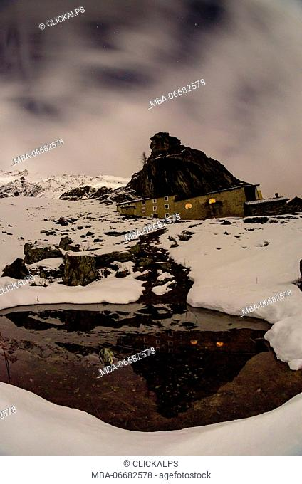 The refuge of San Besso seen in a night, in the beginning of winter. (Val Soana, Piedmont, Gran Paradiso National Park, Italy)