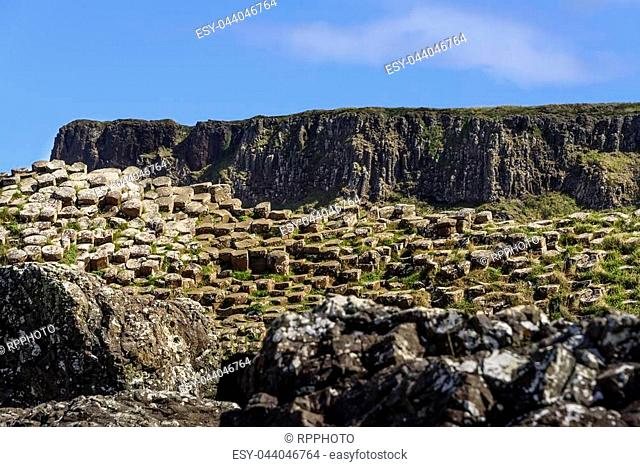 Giants Causeway, in Northern Ireland, a coastline filled with natural interlocking basalt columns, the remnants from an ancient volcanic fissure eruption