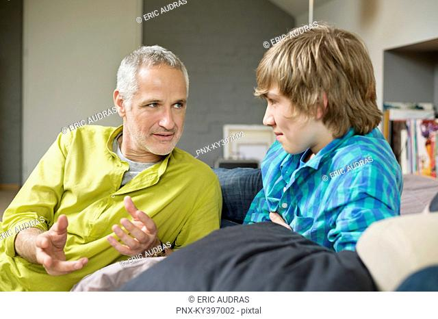 Man talking with his son at home