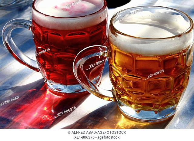 Beer and redcurrant beer in dimpled glass jugs