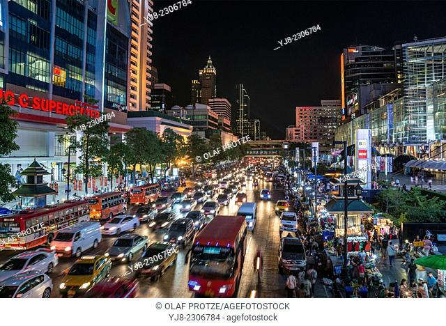 Streetscape with traffic jam in the city centre of Bangkok at night, Thailand