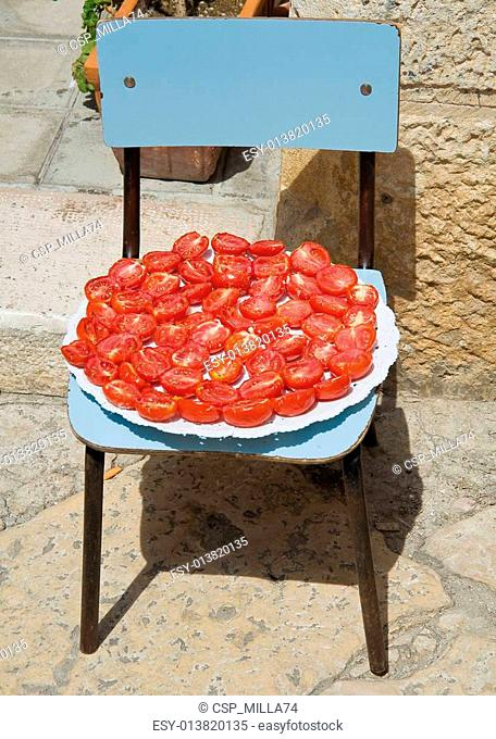 Half tomatoes on blue chair