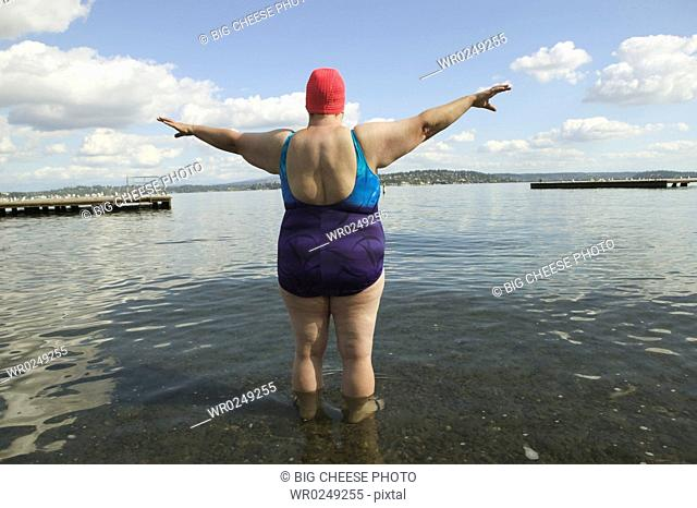 Rear view of a large woman in a bathing suit