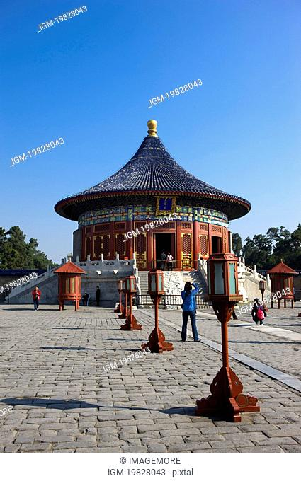 China, Beijing, Woman taking a picture in Temple Of Heaven Park
