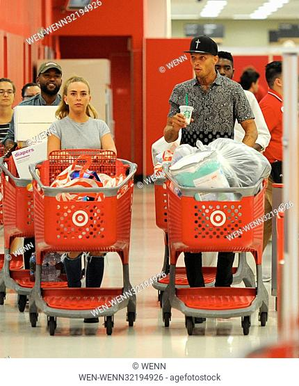 Model Jeremy Meeks and fiancee Chloe Green buying 4 cartloads of goodies at Target for Hurricane Harvey relief. Chloe was seen wearing her new engagement ring...