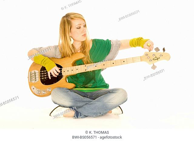 young woman, musician with electric guitar