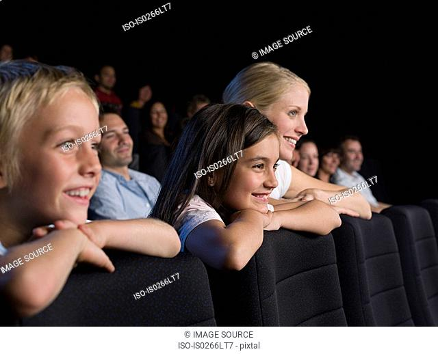 A mother and her children watching a movie
