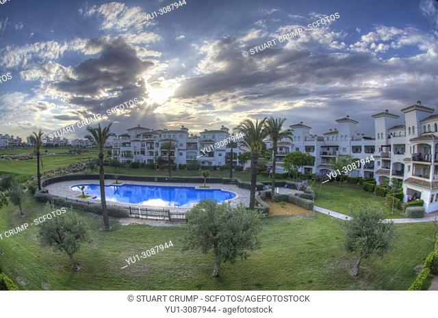 HDR image of a pool area and apartments at Hacienda Riquelme Golf Resort in Murcia Spain
