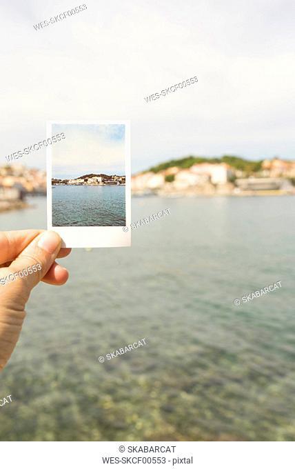 Hand holding souvenir picture of Port-Vendres