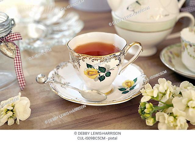 Quaint teacup and saucer on table
