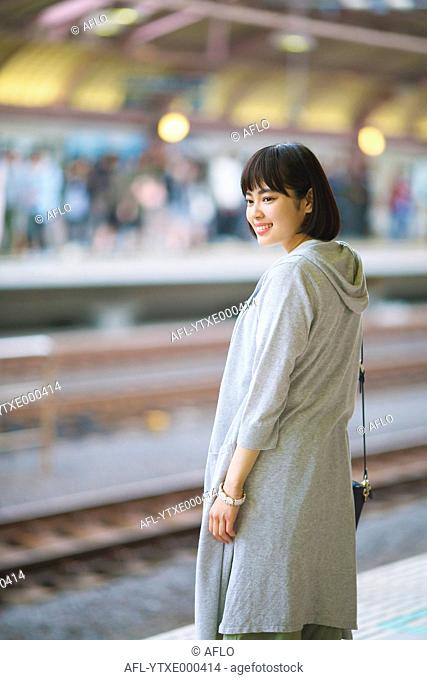 Young Japanese woman at train station