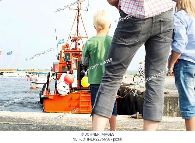 Family looking at boat