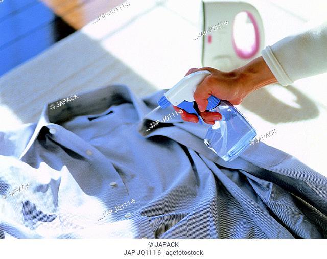 Spraying shirt with water