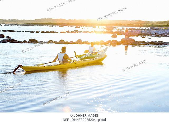 People kayaking at evening