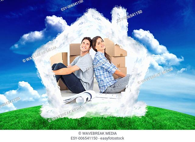 Composite image of beautiful couple sitting back-to-back