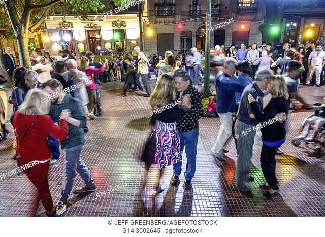 Argentina, Buenos Aires, San Telmo, Plaza Dorrego, night nightlife, tango dancers, dancing, man, woman, couple, audience, watching, performing, Hispanic