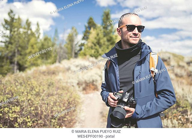 USA, Wyoming, man with camera at Grand Teton National Park