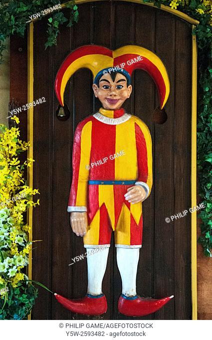 Jester figure adorns a doorway in the Golden Lane at Prague Castle, Czech Republic