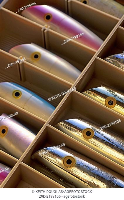 Close-up of salmon fishing tackle box with trolling plugs