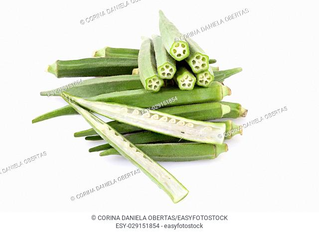 Okra pods whole and sectioned, isolated on white background