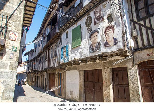 Street and portraits on facades of houses. Mogarraz, Sierra de Francia Nature Reserve, Salamanca province, Castilla Leon, Spain