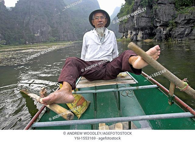 Unusual foot rowing Tam Coc area of Ngo Dong River near Ninh Binh north Vietnam