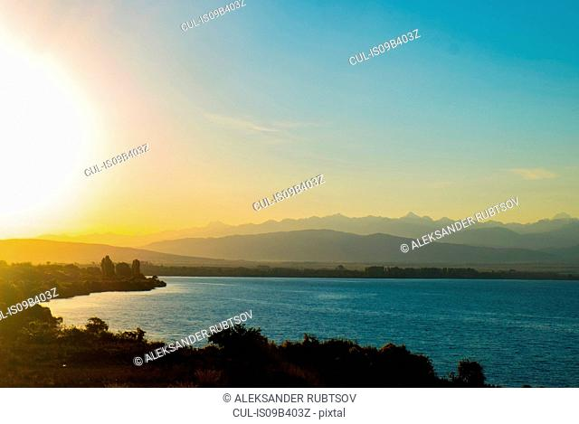 Landscape view of lake and mountains at sunrise, Kyrgyzstan, Central Asia