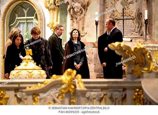 Queen Silvia of Sweden (C), Saxon Premier Stanislaw Tillich and pastor Holger Treutmann (r) visit the Church of Our Lady in Dresden, Germany, 07 February 2014