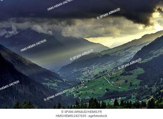 France, Savoie, Beaufortain, Hauteluce, Hauteluce valley since Joly neck at sunset, under a cloudy sky