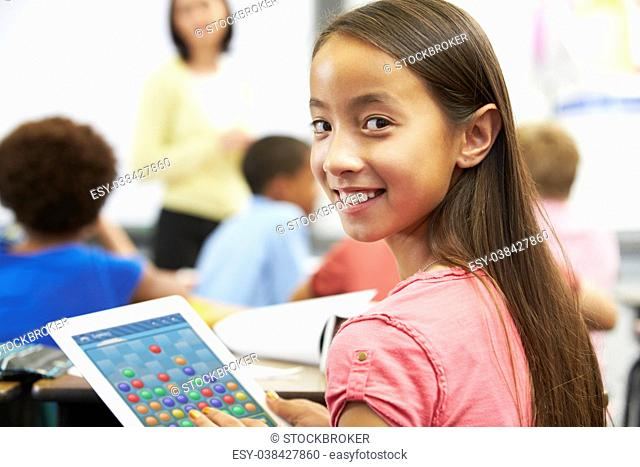 Pupil In Class Playing a Game on a Tablet