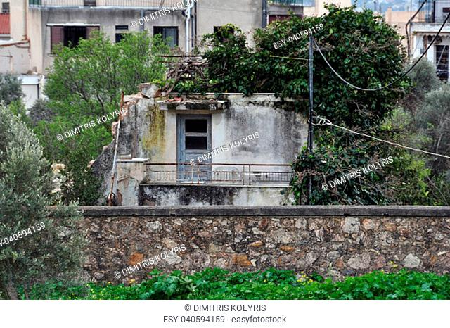 Old abandoned house reclaimed by nature. Urban ruin and overgrown plant